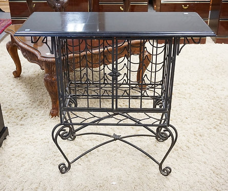 GRANITE TOPPED WROUGHT METAL BAR WITH A WINE RACK CENTER. 38 INCHES WIDE. 35 1/2