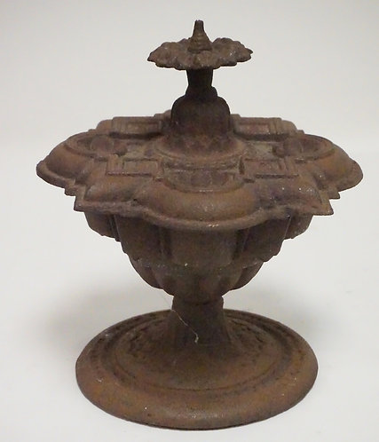CAST IRON ORNAMENTAL URN WITH LUID. 10 1/2 INCHES HIGH.