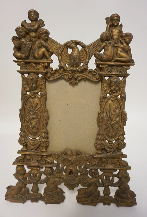ORNATE ANTIQUE CAST IRON FRAME W/ CHERUBS, TORCHES AND MUSICAL INSTRUMENTS. 10 1