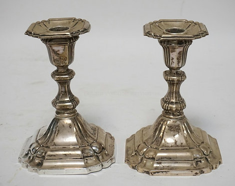 PAIR OF GERMAN STERLING SILVER CANDLESTICKS. 6 1/2 INCHES HIGH. ONE HAS A DENT O