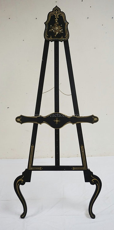 EASEL IN BLACK PAINT WITH GOLD TRIM AND MOTHER OF PEARL ACCENTS. 72 INCHES HIGH.