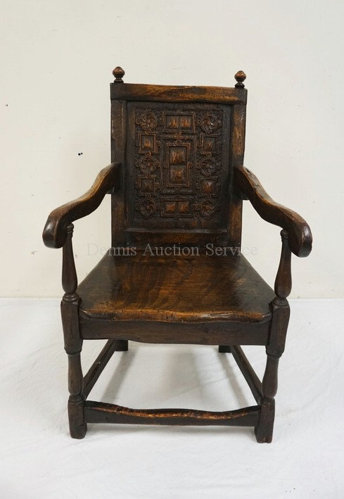 EARLY ANTIQUE OAK ARMCHAIR WITH A CARVED BACK PANEL. 41 1/2 INCHES HIGH. 23 INCH