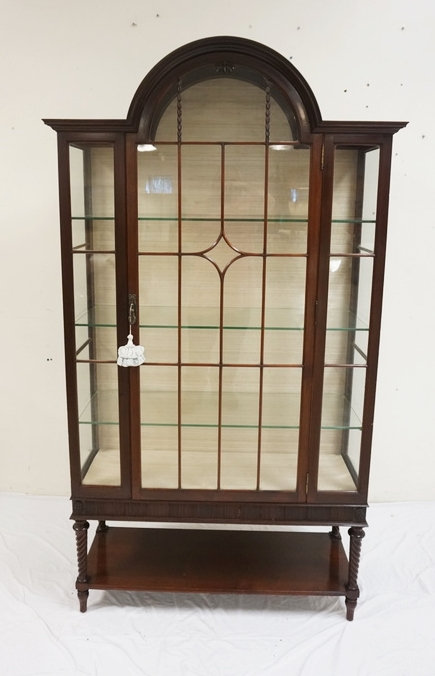 IRISH CARVED MAHOGANY CHINA CABINET. 75 INCHES HIGH. 41 3/4 INCHES WIDE.