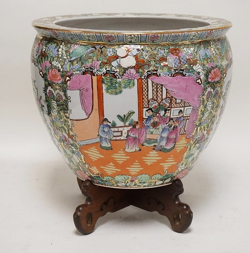 ASIAN PORCELAIN PLANTER WITH A CARVED WOODEN STAND. 15 INCHES WIDE. 15 INCHES HI