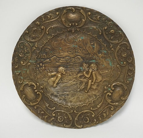 RELIEF DECORATED PLAQUE DECORATED WITH PUTTI FIGURES PLAYING BY WATER. 12 5/8 IN