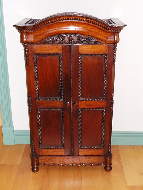 CARVED WALNUT CABINET. PANELED DOORS. ARCH TOP. 54 1/2 INCHES HIGH. 32 1/4 INCHE