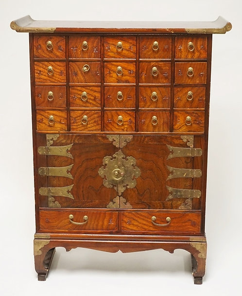ASIAN CABINET HAVING 22 DRAWERS AND 2 DOORS. 31 INCHES HIGH. 24 INCHES WIDE.