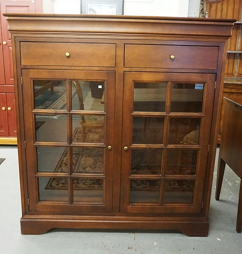 BOKCASE WITH 2 DRAWERS OVER 2 GLASS DOORS. 61 1/4 INCHES HIGH. 57 INCHES WIDE.