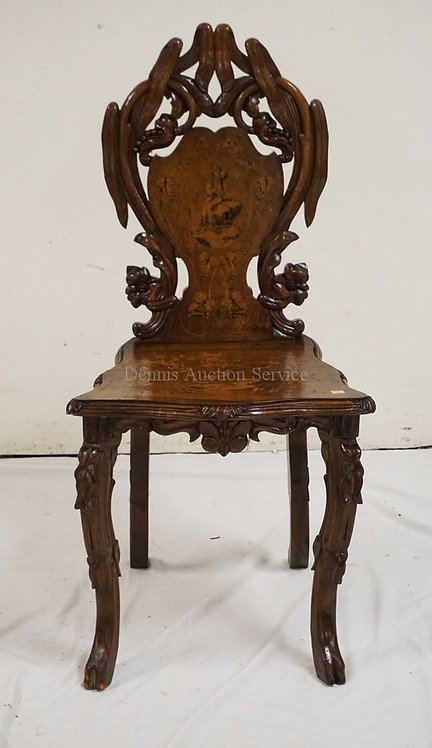 CARVED AND INLAID SIDE CHAIR. INLAY INCLUDES SCENES OF A MAN SITTING ON A ROCK A