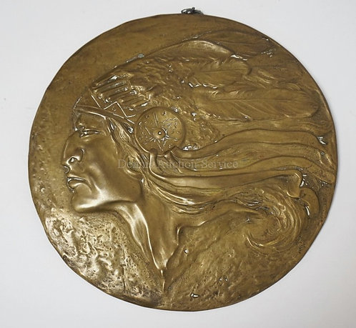 CAST BRONZE PLAQUE OF A NATIVE AMERICAN INDIAN. SIGNED *BERN*. 9 INCH DIA.