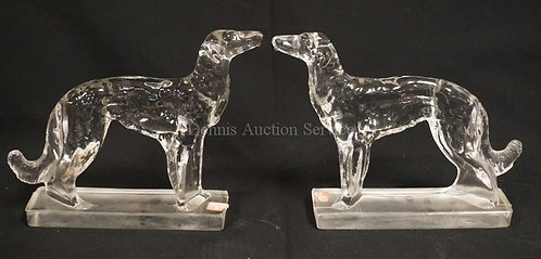 PAIR OF CLEAR GLASS DOG BOOKENDS BY VIKING. 7 1/4 INCHES HIGH. EACH WITH A BASE