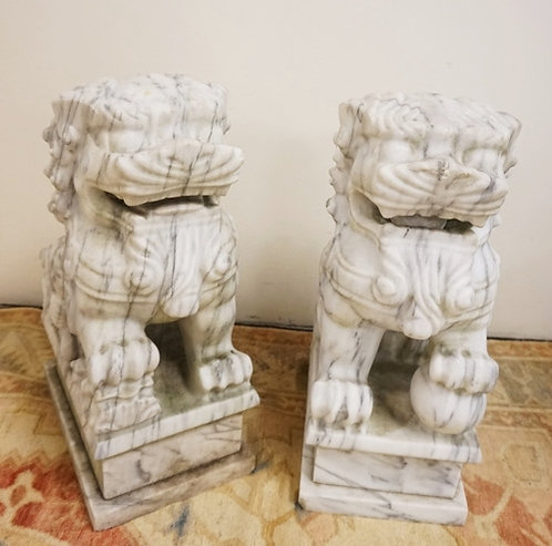PAIR OF MARBLE FOO DOGS MEASURING 19 INCHES HIGH. 8 INCHES WIDE. 12 INCHES DEEP.