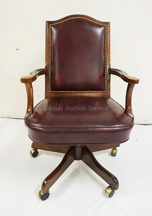 LEATHER SWIVEL OFFICE CHAIR MEASURING 39 1/2 INCHES HIGH AND 25 INCHES WIDE.