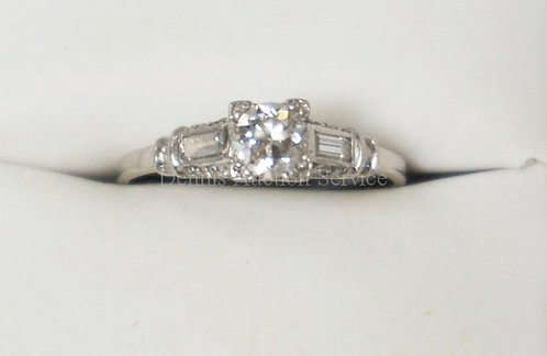 PLATINUM LADIES DIAMOND RING. APPROX 1/2 CT VERY CLEAR MAIN STONE FLANKED BY 2 B