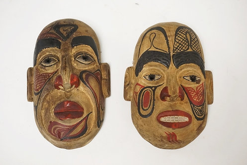 PAIR OF CARVED AND HAND PAINTED MASKS FROM KAIEN ISLAND. 5 3/8 INCHES LONG.