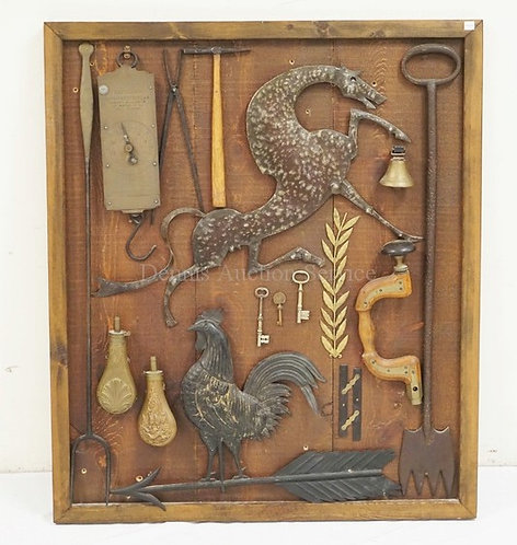 FRAMED COLLECTION OF ANTIQUE ITEMS INCLUDING A SPRING SCALE, SHOT FLASKS, A BRAS