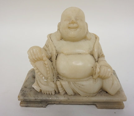 CARVED SOAPSTONE BUDDHA MEASURING 4 3/4 INCHES HIGH.