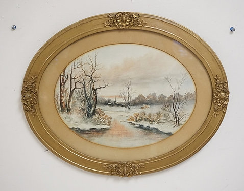 FRAMED WATERCOLOR OF A WINTER SCENE IN AN OVAL GOLD GILT FRAME. 14 1/4 X 10 1/2