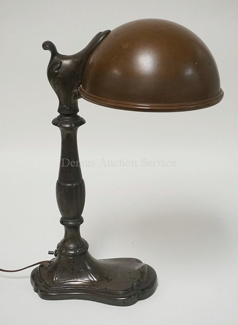 DESK LAMP WITH A WHITE METAL BASE AND A DOMICAL COPPER SHADE. 18 3/4 INCHES HIGH