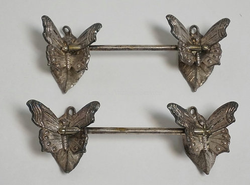 PAIR OF SILVER PLATED KNIFE RESTS IN THE FORM OF BUTTERFLIES. 5 1/2 INCHES LONG.