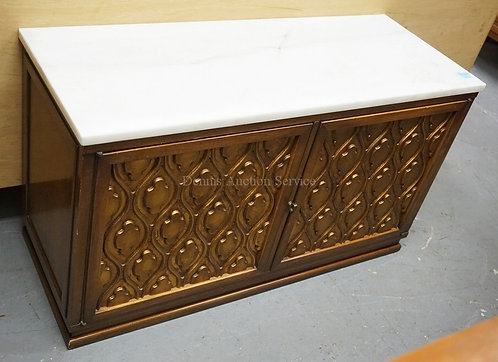 2 DOOR CABINET WITH A MARBLE TOP AND CARVED DOORS. 39 INCHES WIDE. 22 INCHES HIG