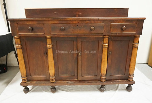 EMPIRE MAHOGANY SIDEBOARD WITH HALF COLUMNS. 69 INCHES WIDE. 51 INCHES HIGH. HAS