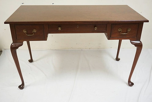 MAHOGANY 3 DRAWER DESK WITH CABRIOLE LEGS. 24 X 50 INCH TOP. 29 1/2 INCHES HIGH.