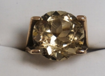 14K GOLD RING WITH A LARGE SMOKEY TOPAZ STONE, HAS A SMALL CHIP ON THE EDGE. 5.2