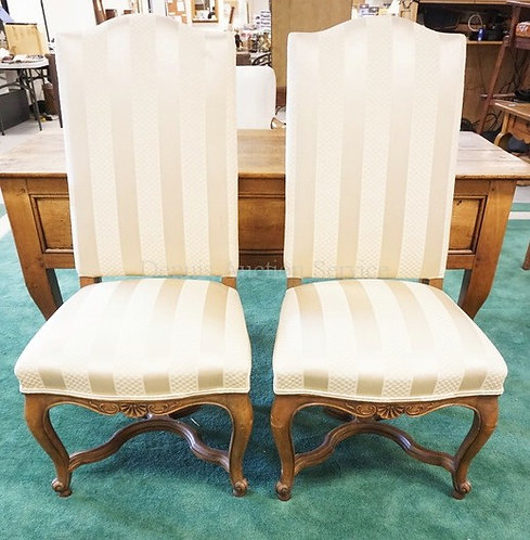 PAIR OF CARVED WALNUT AND UPHOLSTERED CHAIURS. 45 INCHES HIGH.