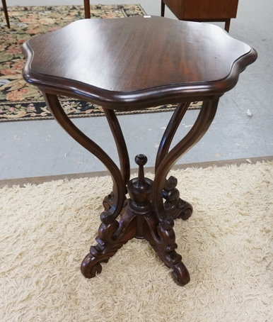 MAHOGANY LAMP TABLE. HEXAGONAL TOP WITH A CARVED BASE. 28 1/2 INCHES HIGH. 23 1/
