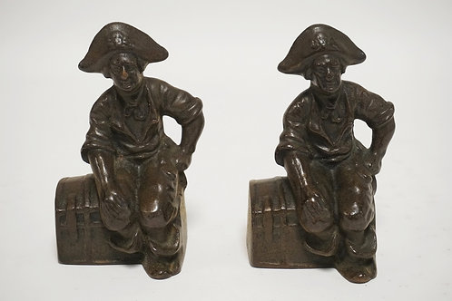 PAIR OF FIGURAL CAST IRON BOOKENDS DEPICTING PIRATES SEATON ON TREASURE CHESTS.