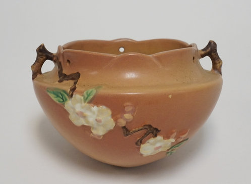 ROSEVILLE ART POTTERY HANGING BASKET IN THE CHERRY BLOSSOM PATTERN. 7 3/4 INCHES