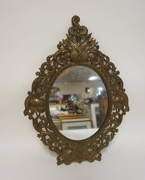 CAST IRON OVAL FRAME WITH MIDIEVAL MILITARY D�COR, SHIELDS, HELMETS AND WEAPONRY