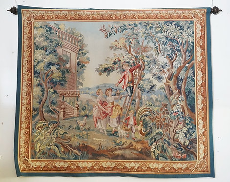 LARGE TAPESTRY WITH A EAROPEAN SCENE DEPICTING A MAN PICKING FRUIT FROM A TREE.