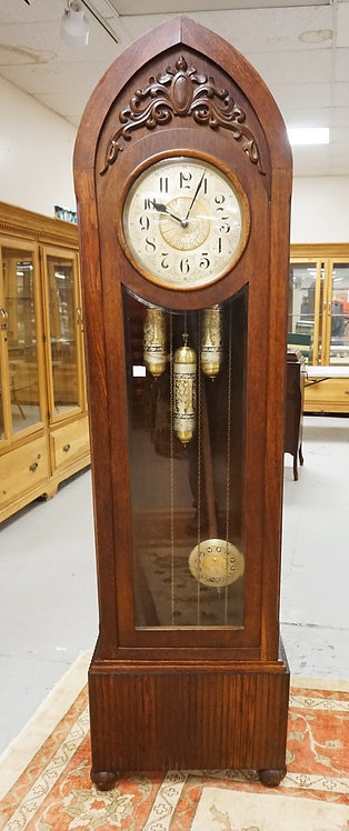GERMAN CARVED OAK TALL CASE CLOCK. 82 INCHES HIGH. 23 INCHES WIDE.