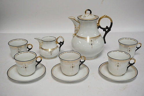 10 PIECES OF MATCHING PORCELAIN. A TEAPOT, CREAMER, 5 CUPS AND 3 SAUCERS. INCISE