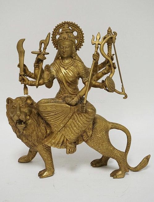 BRONZE HINDU SCULPTRURE OF DURGA RIDING ATOP A LION. 11 1/2 INCHES HIGH.