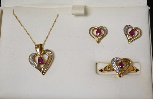 10K GOLD RUBY AND DIAMOND 4 PIECE JEWELRY SET INCLUDING A RING (APPROX SIZE 7),