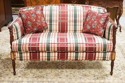 SHERATON STYLE MAHOGANY LOVESEAT. FLUTED LEGS. PLAID UPHOLSTERY. 53 1/2 INCHES W