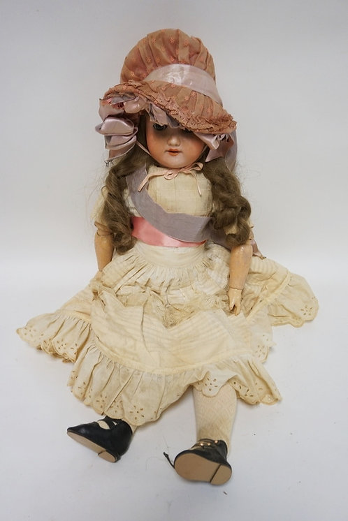 ARMAND MARSEILLE *WELSCH* BISQUE HEAD DOLL MEASURING 24 INCHES LONG.