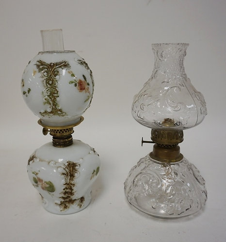 2 VICTORIAN MINIATURE LAMPS, ONE MILK GLASS, ONE CLEAR. TALLEST 9 1/2 IN