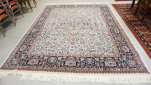 ROOM SIZE RUG MEASURING 10 FT 2 INCHES X 8 FT 2 INCHES.
