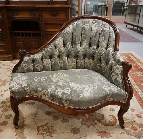 CARVED WALNUT VICTORIAN BUSTLE CHAIR WITH TUFTED BACK.38 IN WIDE, 32 IN H