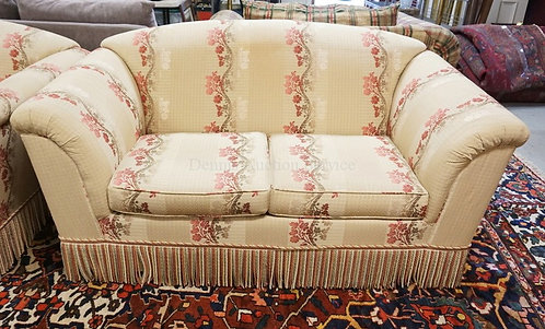 UPHOLSTERED LOVESEAT WITH FLORAL VINE PATTERNS AND MATCHING PIPING AND FRINGE. 6