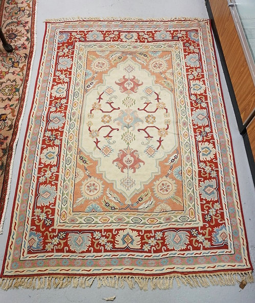 WOVEN AREA RUG MEASURING 6 FT X 4 FT 1 INCHES.