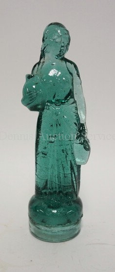 ANTIQUE BLUE/GREEN GLASS FIGURE OF A PARTIALLY NUDE WOMAN CARRYING 2 JUGS. BASE