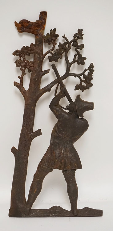 CAST IRON PANEL DEPICTING A PILGRIG SHOOTING AN ANIMAL OUT OF A TREE. 18 1/2 INC
