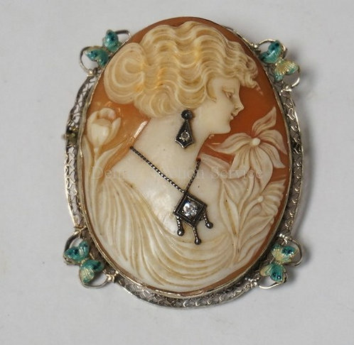 LARGE CARVED CAMEO BROOCH/PENDANT WITH A WHITE GOLD FRAME HAVING ENAMELED BUTTER