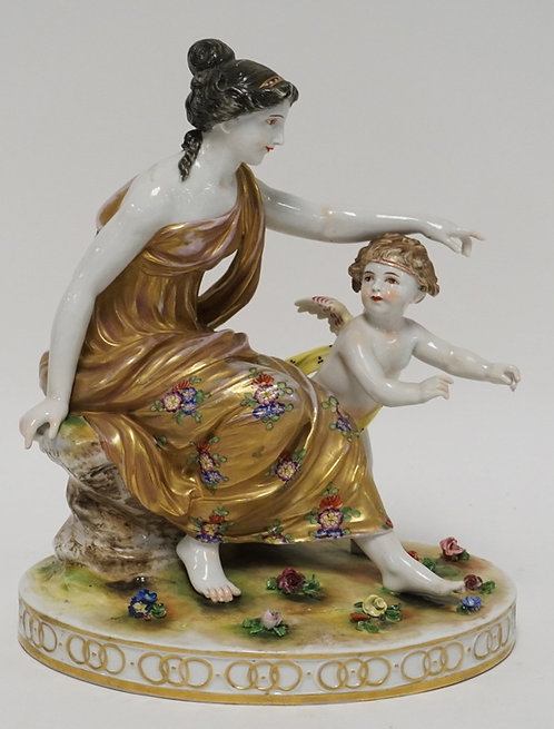 PORCELAIN FIGURE OF A WOMAN AND A CHERUB. HAND PAINTED. 11 INCHES HIGH.