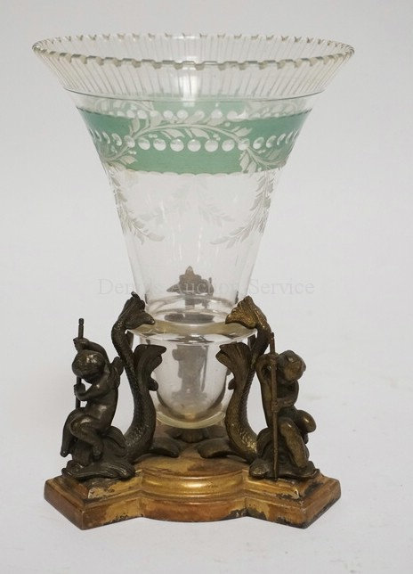 ANTIQUE SILVER PLATED AND CUT GLASS VASE. THE BASE HAVING CHERUBS RIDING DOLPHIN
